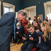 07/03/2019<br /> Eli O'Sullvian, 1st class, from Bulgaden NS, works out a maths question put to him by JP McManus, alongside senior infant student Carla O'Brien, and teacher Charlotte Reidy at the 'Design a TLC Bottle' prizegiving at the Hunt Museum, Limerick. Over 50 primary schools across the county entered ahead of Team Limerick Clean-Up 5, which will see thousands of volunteers take to the streets of Limerick city and county for Europe's largest one-day clean up. Sponsored by the JP McManus Benevolent Fund, the event has seen over 360 tonnes of litter gathered from the streets since inception in 2015. Over 14,000 volunteers have already signed up for the 2019 event, taking place on Good Friday, 19th April. <br /> Photo by Diarmuid Greene