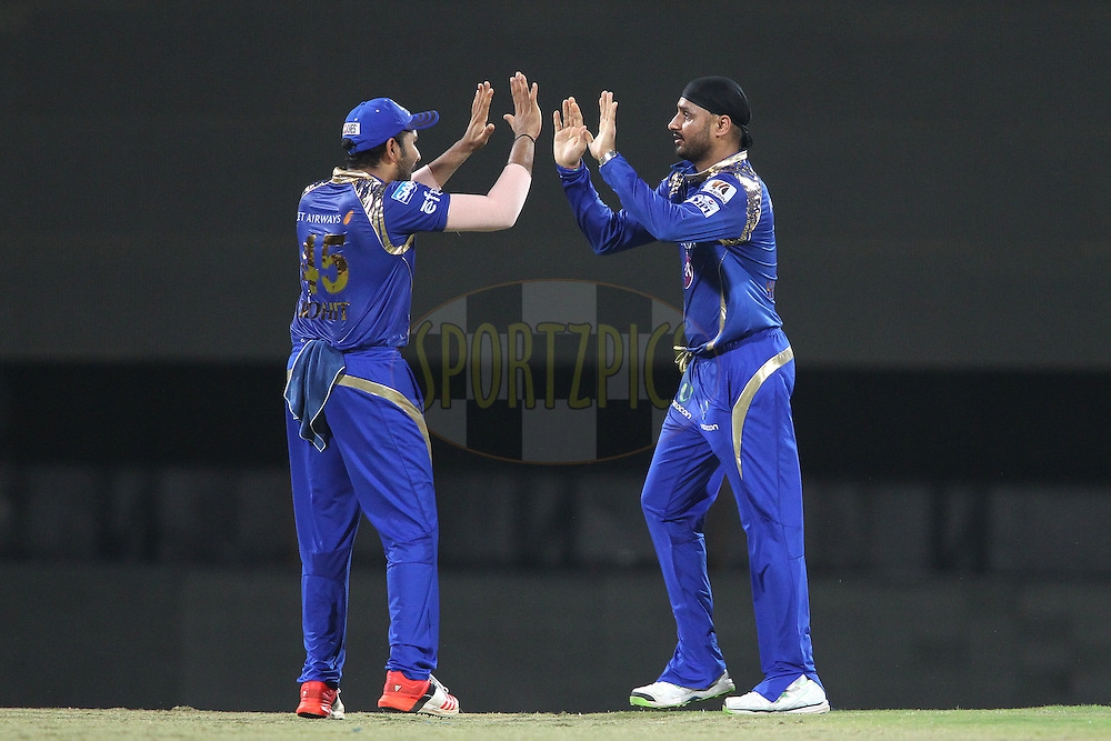 Mumbai Indians captain Rohit Sharma congratulates Harbhajan Singh of Mumbai Indians for getting Dwayne Smith of Chennai Super Kings wicket during match 43 of the Pepsi IPL 2015 (Indian Premier League) between The Chennai Super Kings and The Mumbai Indians held at the M. A. Chidambaram Stadium, Chennai Stadium in Chennai, India on the 8th May April 2015.<br /> <br /> Photo by:  Shaun Roy / SPORTZPICS / IPL