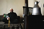 Mehemet Çinar, 81, fingers his prayer beads and prays throughout the day, in addition to the required 5 times a day for the Muslim faithful. Golden Horn (or Haliç) area, Istanbul, Turkey. Muslim, Islam, Religion, Elderly.