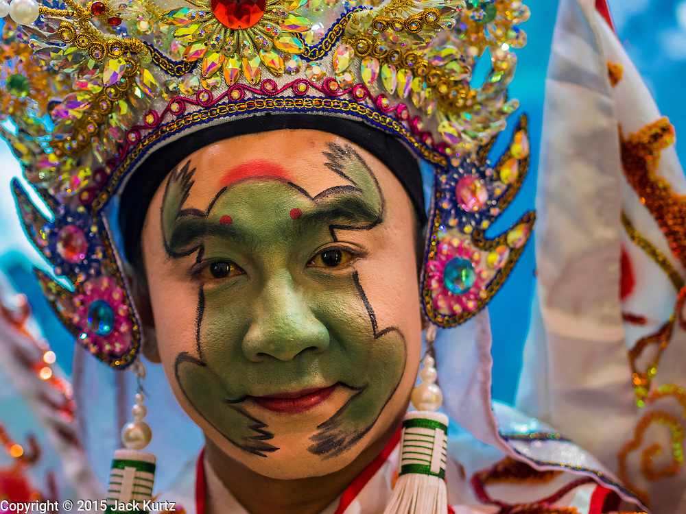 16 JANUARY 2015 - BANGKOK, THAILAND: A performer with the Sai Yong Hong Opera Troupe with his face made up to be resemble a frog gets ready to go on stage at the Chaomae Thapthim Shrine, a Chinese shrine in a working class neighborhood of Bangkok near the Chulalongkorn University campus. The troupe's nine night performance at the shrine is an annual tradition and is the start of the Lunar New Year celebrations in the neighborhood. Lunar New Year, also called Chinese New Year, is officially February 19 this year. Teochew opera is a form of Chinese opera that is popular in Thailand and Malaysia.    PHOTO BY JACK KURTZ