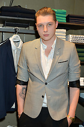 JOHN NEWMAN at a party to celebrate the reopening of the Lacoste Premium Store at 233 Regent Street, London on 28th May 2014.
