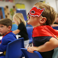"Lauren Wood | Buy at photos.djournal.com<br /> Warner Bryan, 3, sings along with the class while dressed as Captain America in Room 6 ""All By Myself"" Tuesday morning at the NMMC Child Care Center."