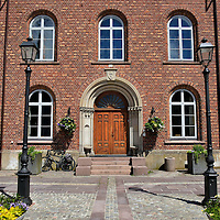 R&aring;dhuset or Town Hall in Kristiansand, Norway<br /> This neo-classical style R&aring;dhuset was built in 1864 along the town&rsquo;s main square called Torvet. It houses the Kristiansand Commune or municipality offices. With a population of about 150,000 people, Kristiansand is the fifth largest of Norway&rsquo;s 428 municipalities.  It is also the capital of Southern Norway&rsquo;s VestAgder County.