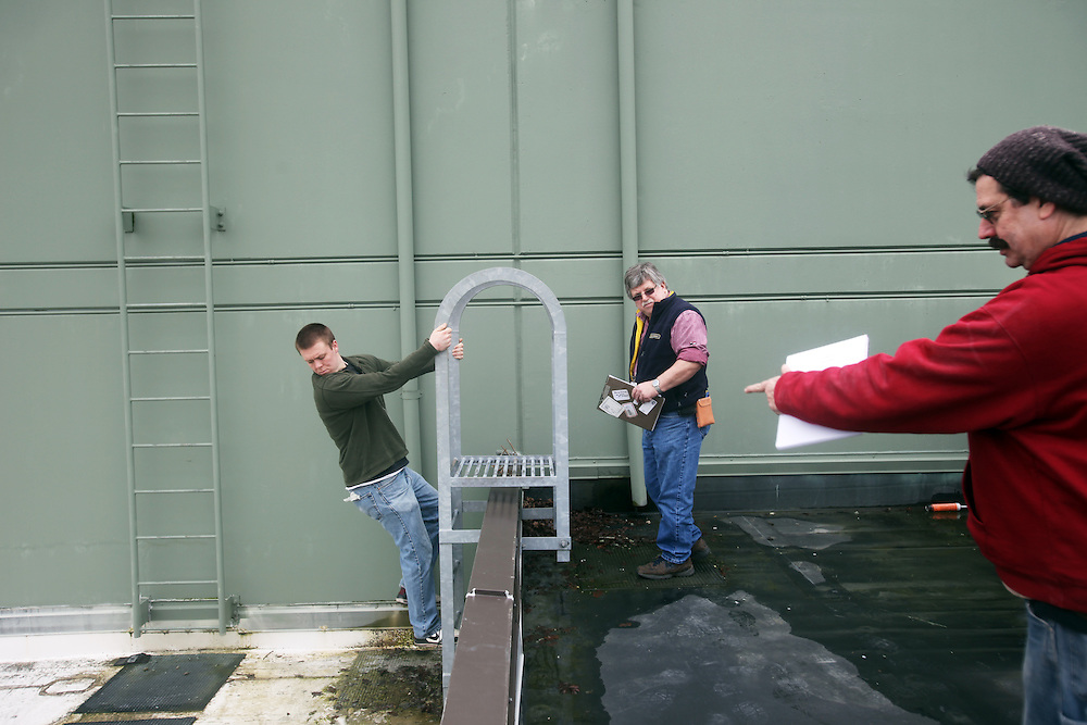 Sean Williamson, Alford and Steven Marcyk, from left. Lane Community College energy management instructor Bruce Alford and his students inspect boilers, lighting and air condiiton units to build an energy audit of Judson Middle School in Salem on Friday, March 4, 2011.