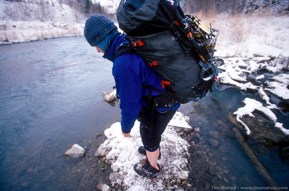 Kristie Arend hesitates before a mandatory January river crossing for the ice climb Shriek of the Sheep near Lillooet, British Columbia.