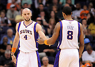 Mar. 12, 2012; Phoenix, AZ, USA; Phoenix Suns center Marcin Gortat (4) and forward Channing Frye (8) react while playing  against the Minnesota Timberwolves at the US Airways Center. The Timberwolves defeated the Suns 127-124. Mandatory Credit: Jennifer Stewart-US PRESSWIRE.