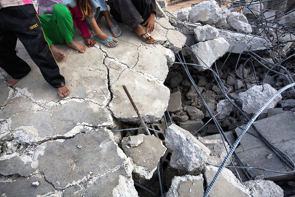 Children stand on the roof of a makeshift mosque that was destroyed the day before. Dec. 4, 2013. West Bank, Palestinian Territories. (Photo by Gabriel Romero/Alexia Foundation ©2014)