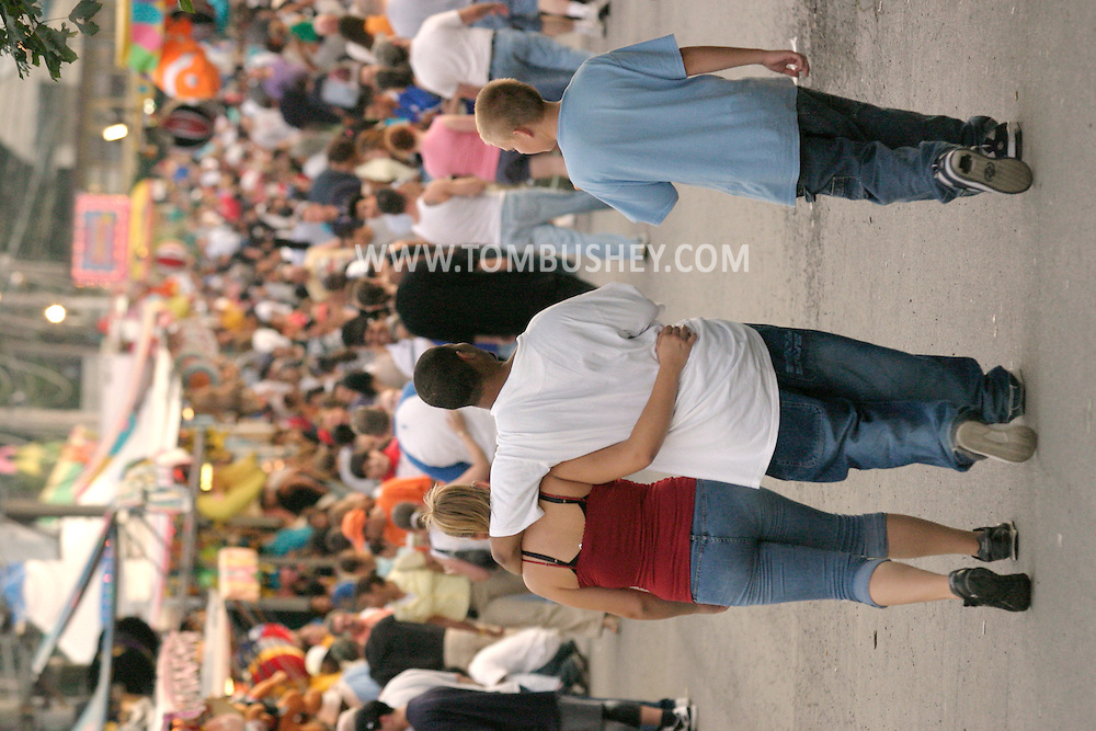 Mechanicstown, N.Y. - Teenagers walk down the midway at the Orange County Fair on July 29, 2006. ©Tom Bushey