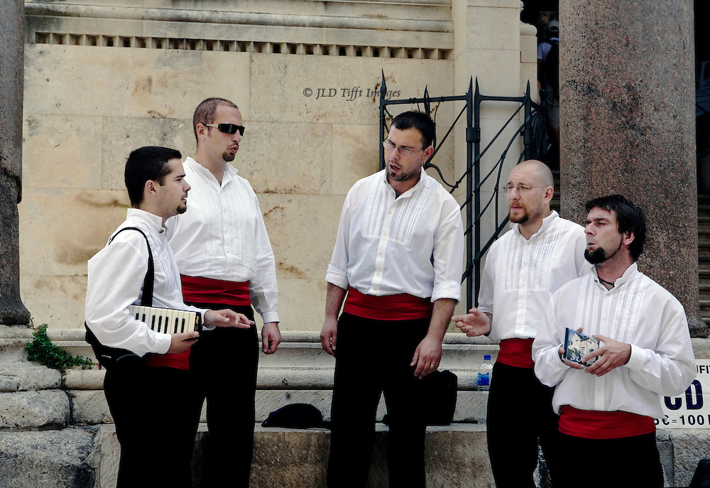 Split: quintet of male acapella singers perform in the peristyle of Diocletians Palace, selling their CD.