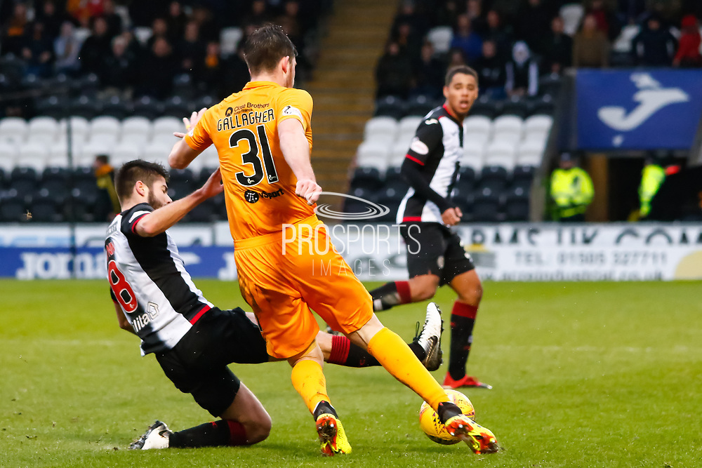 Ryan Flynn of St Mirren goes to ground to challenge Declan Gallagher of Livingston during the Ladbrokes Scottish Premiership match between St Mirren and Livingston at the Simple Digital Arena, Paisley, Scotland on 2nd March 2019.