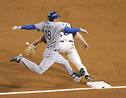 Phoenix, AZ 07-15-04 L.A.Dodgers' Jose Hernandez reaches 1st safely in the first inning. The Dodgers came from behind to win 4-3. Ross Mason photo
