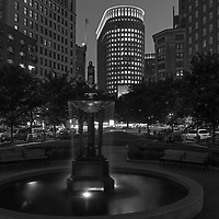 Boston skyline B&amp;W photography from New England photographer Juergen Roth showing the Boston Statler Park and parts of its fountain with the Boston Park Plaza to the right. The left features a rental apartment complex. I noticed the fountain and phot opportunity when I picked up my wife from a gala at the Boston Plaza Hotel. The fountain inspired me to come back at twilight and create this long-exposure photography image of the Boston cityscape. <br />