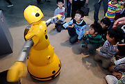 "Young visitors watch Mitsubishi Heavy's Wakamaru talking robot do a dance at Robo Japan 2008 in Yokohama, Japan on Saturday 09 October 2008. Wakamaru stands at  1-meter in height and is equipped with multiple sensors and audio/visual processing functions. Defined as a ""communication robot"" by MHI, it can have simple conversations with users while looking into their eyes and can even tell the time and play simple games, such as rock, scissors, paper."
