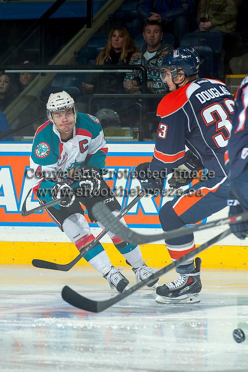 KELOWNA, CANADA -FEBRUARY 1: Madison Bowey #4 of the Kelowna Rockets makes a pass against the Kamloops Blazers on February 1, 2014 at Prospera Place in Kelowna, British Columbia, Canada.   (Photo by Marissa Baecker/Getty Images)  *** Local Caption *** Madison Bowey;