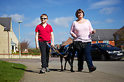 Toby and his mum, Vikki, out for a walk with Sox.<br /> <br /> Before getting their assistance dog,  Sox, Toby used to spend 80% of his time in his bedroom and wouldn't go out for a walk with the family.