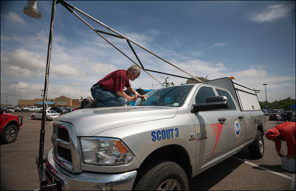 Tim Marshall prepping the windshield on Scout 3 in a Walmart parking lot before a big day of collecting data for the TWIRL project with CSWR.