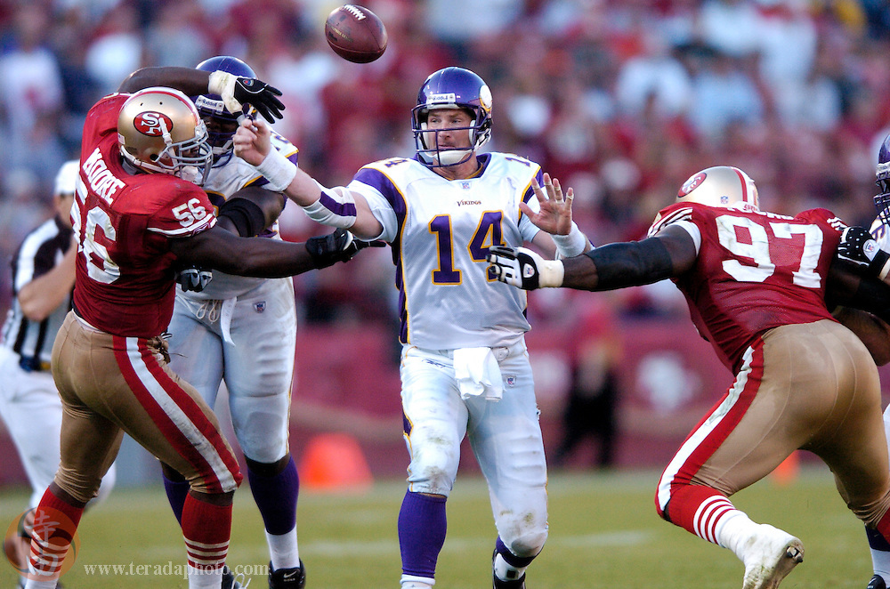 Nov 5, 2006 San Francisco, CA, USA: San Francisco 49ers linebacker Brandon Moore (56) forces Minnesota Vikings quarterback Brad Johnson (14) to fumble the football during the second half at Monster Park. The 49ers defeated the Vikings 9-3.