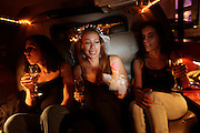 Marilu holds a rubber penis as she her friends enjoy the night ride on rented limo around the wealthy neighborhoods of MIraflores, San Isidro and Chorrillos in the booming Peruvian capital, Thursday, April 14, 2011. A smart woman on her late 30's she is about to marry with an Italian guy and leave the country where she was born, raised and spent most of her live. That's the tale of her bridal shower and how her friends said farewel.  (Dado Galdieri)