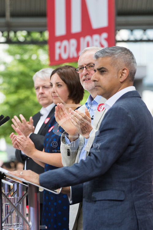 Kings Cross, London, June 22nd 2016. A final rally by members of the Labour Party's Vote Remain team is held in King's Cross, bringing London mayor Sadiq Khan, Welsh first minister Carwyn Jones, Labour In For Britain head Alan Johnson and Scottish leader Kezia Dugdale and Party Leader Jeremy Corbyn in a show of unity as they express the importance of a Remain vote. PICTURED: Mayor of London Sadiq Khan is applauded by Welsh first minister Carwyn Jones, Scottish leader Kezia Dugdale and Jeremy Corbyn after addressing the crowd.