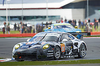 Khaled Al Qubaisi (ARE) / David Heinemeier Hansson (DNK) / Patrick Long (USA) #88 Abu Dhabi Proton Racing Porsche 911 RSR, during during the first hour or the race  as part of the WEC 6 Hours of Silverstone 2016 at Silverstone, Towcester, Northamptonshire, United Kingdom. April 17 2016. World Copyright Peter Taylor.