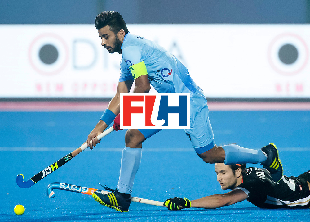 BHUBANESWAR - The Odisha Men's Hockey World League Final . Manpreet Singh (Ind) with Marco Miltkau (Ger) during  the match India v Germany. WORLDSPORTPICS COPYRIGHT  KOEN SUYK