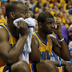 April 22, 2011; New Orleans, LA, USA; New Orleans Hornets power forward Carl Landry (24) and point guard Chris Paul (3) watch from the bench during the fourth quarter in game three of the first round of the 2011 NBA playoffs at the New Orleans Arena. The Lakers defeated the Hornets 100-86.   Mandatory Credit: Derick E. Hingle
