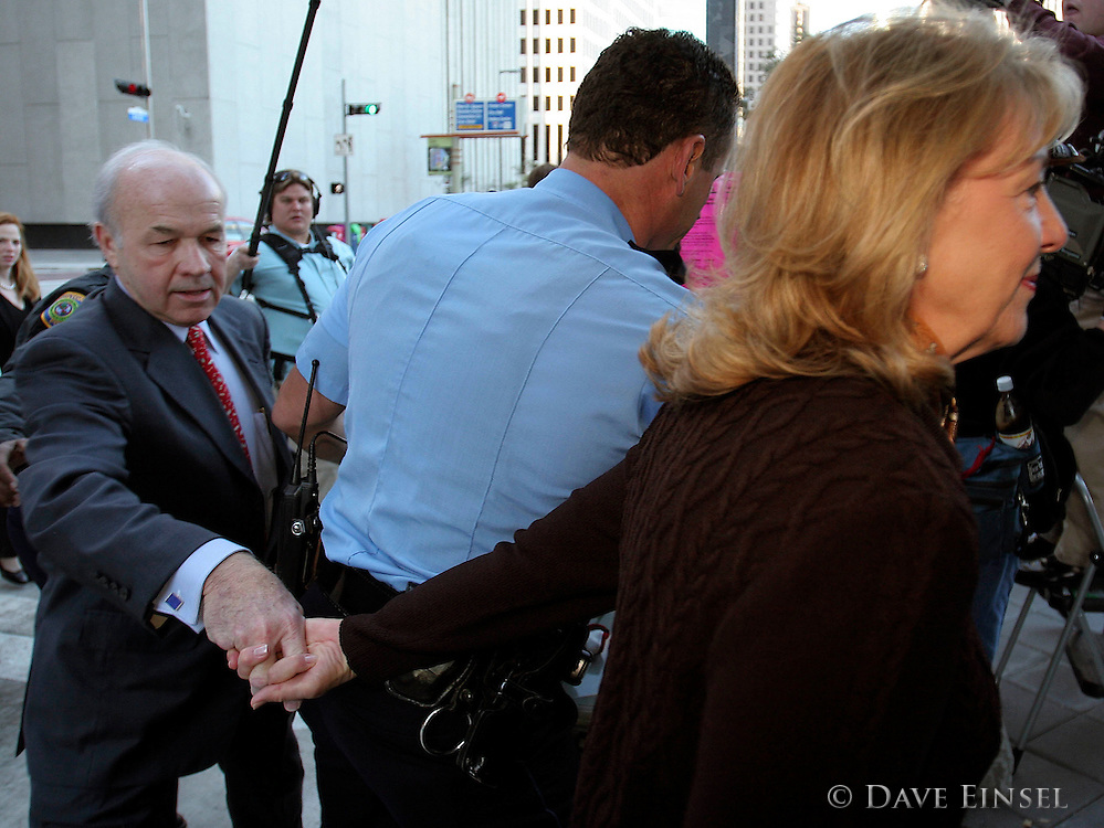 HOUSTON -  JANUARY 31:  Former Enron chairman Kenneth Lay is led by his wife Linda as they arrive at the Bob Casey United States Courthouse for the second day of his fraud and conspiracy trial, January 31, 2006 in Houston, Texas. Lay is charged in 11 counts related to the collapse of Enron in 2001. (Photo by Dave Einsel)