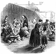 Teaching girls to read in The Ragged School Union (formed 1844) school, Lambeth, London.  From 'The Illustrated London News' 11 April 1868. Wood engraving.