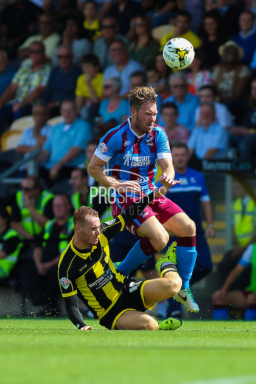Burton Albion's Tom Naylor puts in a hard challenge on Scott Laird during the Sky Bet League 1 match between Burton Albion and Scunthorpe United at the Pirelli Stadium, Burton upon Trent, England on 8 August 2015. Photo by Aaron Lupton.