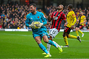 Watford goalkeeper Ben Foster (26) catches the ball ahead of the advance from AFC Bournemouth forward Callum Wilson (13) during the Premier League match between Watford and Bournemouth at Vicarage Road, Watford, England on 26 October 2019.