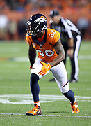 An official steadies Denver Broncos wide receiver Demaryius Thomas (88) goes out for a pass during the 2016 NFL week 1 regular season football game against the Carolina Panthers on Thursday, Sept. 8, 2016 in Denver. The Broncos won the game 21-20. (©Paul Anthony Spinelli)