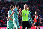 Granit Xhaka (34) of Arsenal puts two fingers up to referee Craig Pawson during the Premier League match between Bournemouth and Arsenal at the Vitality Stadium, Bournemouth, England on 25 November 2018.
