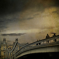 People walking over a bridge