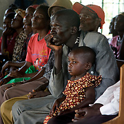 Members of the Barracka HIV/AIDS support group in South Alego village meet with Kenya Learning Tours delegation during a visit to the region. The support group is comprised of 35 women and 15 men who are HIV positive who have come together to support each other and help reduce HIV prevalence in the community.