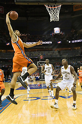 Virginia forward Mike Scott (32) goes up for a dunk against GT.  The Virginia Cavaliers faced the Georgia Tech Yellow Jackets in the first round of the 2008 ACC Men's Basketball Tournament at the Charlotte Bobcats Arena in Charlotte, NC on March 13, 2008.
