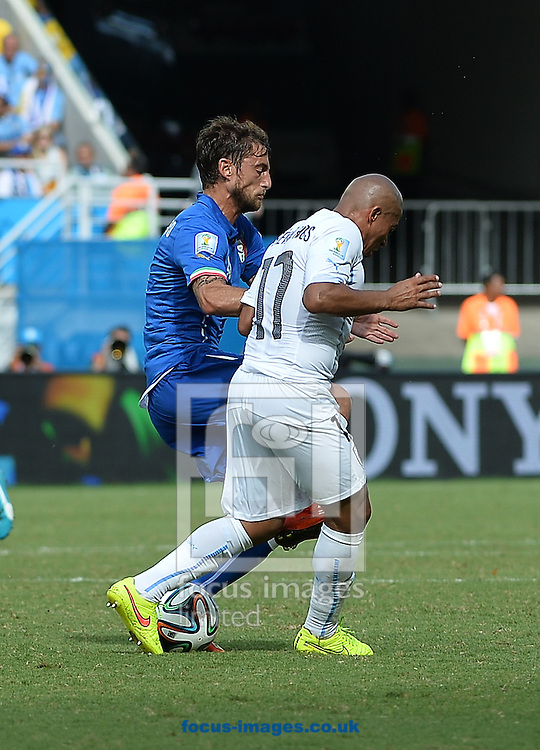 x of Italy and y of Uruguay during the 2014 FIFA World Cup match at Arena das Dunas, Natal<br /> Picture by Stefano Gnech/Focus Images Ltd +39 333 1641678<br /> 24/06/2014