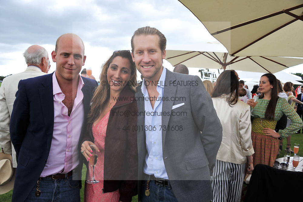 Left to right, CARLO CARELLO,  JAKE & SAMIRA PARKINSON-SMITH at the Cartier Queen's Cup Polo Final, Guards Polo Club, Windsor Great Park, Berkshire, on 17th June 2012.