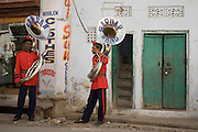Sousaphone players in a marching band take a rest in Udaipur