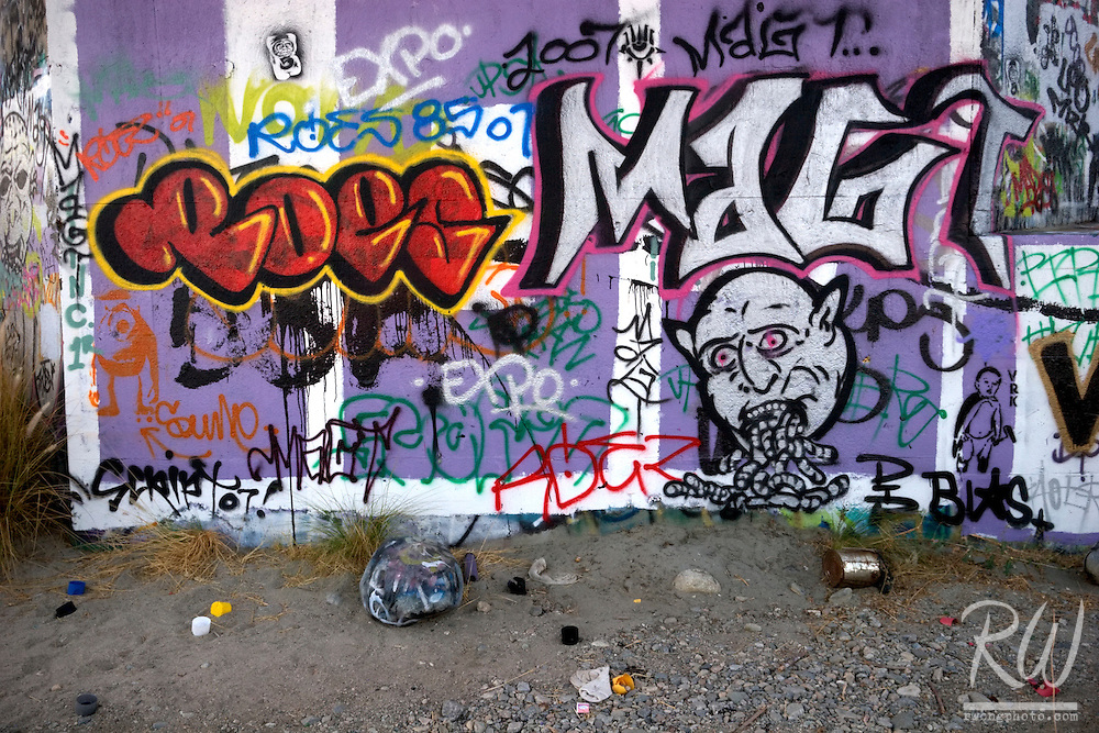 Gang Graffiti on Wall and Spray Paint Cans along the San Gabriel River, California