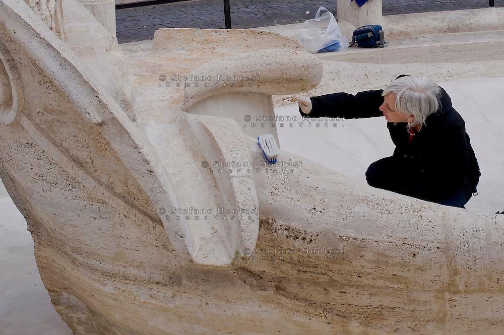 """Roma 20 Febbraio 2015<br /> La fontana della Barcaccia a Piazza di Spagna danneggiata dai tifosi del Feyenoord.  Gli archeologi  della sovrintendenza ai Beni Culturali di Roma, hanno riscontrato «danni permanenti» alla fontana seicentesca. Tecnici al lavoro sulla fontana della Barcaccia <br /> Rome February 20, 2015<br /> The Fountain of Barcaccia in Piazza di Spagna damaged by fans of Feyenoord. Archaeologists of the superintendent of Cultural Heritage of Rome, found """"permanent damage"""" to the seventeenth-century fountain. Technicians working on Fountain of Barcaccia"""