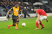 Hull City midfielder Moses Odubajo (2) and Bojan Jokic(3) of Nottingham Forest  during the Sky Bet Championship match between Hull City and Nottingham Forest at the KC Stadium, Kingston upon Hull, England on 15 March 2016. Photo by Ian Lyall.