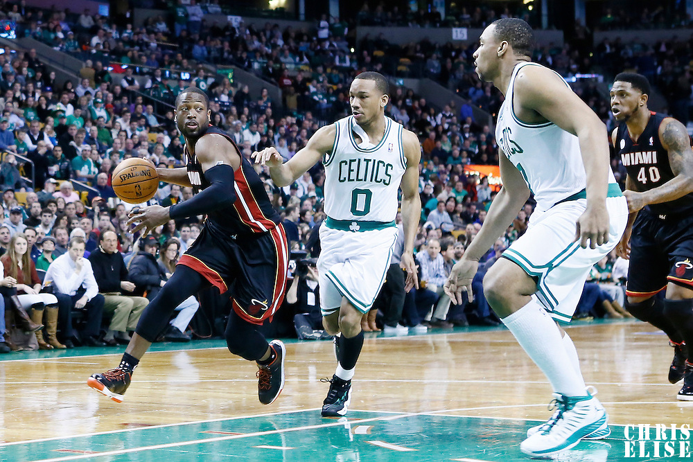 27 January 2013: Miami Heat shooting guard Dwyane Wade (3) drives past Boston Celtics point guard Avery Bradley (0) during the Boston Celtics 100-98  2OT victory over the Miami Heat at the TD Garden, Boston, Massachusetts, USA.