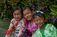 Girls in ceremonial dress at a village festival near Tabanan in Bali, Indonesia