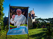 19 NOVEMBER 2017 - HWAMBI, YANGON REGION, MYANMAR: A banner announcing the visit of Pope Francis to Myanmar hangs in front of Sacred Heart's Catholic Church in Hwambi, about 90 minutes north of Yangon. Catholics in Myanmar are preparing for the visit of Pope Francis. He is coming to the Buddhist majority country November 27-30. There about 500,000 Catholics in Myanmar, about 1% of the population. Catholicism was originally brought to what is now Myanmar more than 500 years ago by Portuguese missionaries and traders.    PHOTO BY JACK KURTZ