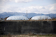Photo shows the giant greenhouse domes at the Minamisoma Agri-Solar Park that have been built on the farmland that was affected by 2011's devastating tsunami and nuclear accident in Minamisoma, Fukushima, just 25 km from the Daiichi plant. More than 2,000 solar panels will power the  domes, inside which farmers affected by the 2011 tsunami and nuclear accident will be able to grow produce.   In the foreground is the concrete foundations of a building flattened by the tsunami. .Photographer: Robert Gilhooly