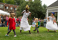 Ines Ouedraogo and Mariona LLoreta from SambaViva teach children how to do the Brazilian Baiana dance during the Multicultural Festival on Saturday.  (Karen Bobotas/for the Laconia Daily Sun)