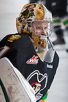 KELOWNA, CANADA - JANUARY 26: Luke Siemens #31 of the Prince Albert Raiders stretches on the ice during warm up at the Kelowna Rockets on January 26, 2013 at Prospera Place in Kelowna, British Columbia, Canada (Photo by Marissa Baecker/Shoot the Breeze) *** Local Caption ***