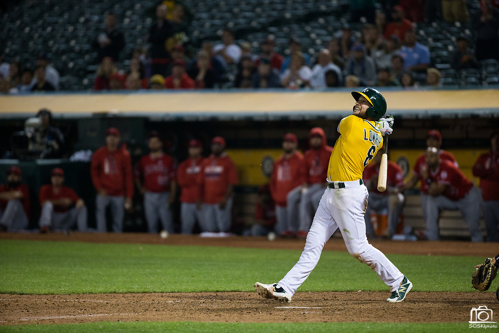 Oakland Athletics second baseman Jed Lowrie (8) hits a pop fly against the Los Angeles Angels at Oakland Coliseum in Oakland, California, on September 5, 2017. (Stan Olszewski/Special to S.F. Examiner)