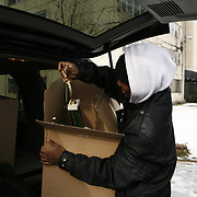 Deonta (cq) Ricks, 25, carries a box full of trophies<br /> on moving day Thursday  December 9, 2010. Cabrini Green resident Annie Ricks was the last person to reside in the Chicago Public Housing Authority's public housing development. <br /> Photography by Jose More