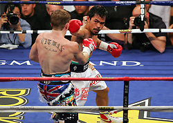 Manny Pacquiao throws a jab before he knocks out Ricky Hatton in the second round of their Light Welterweight title fight at the MGM Grand, Las Vegas , Nevada, 2nd May 2009.